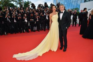 "Cannes, France - May 12, 2016: Hollywood heavyweights steal the spotlight with the most talked about film at Cannes.  US actor George Clooney (R) and his wife, British-Lebanese lawyer Amal Clooney pose as they arrive for the screening of the film ""Money Monster"" at the 69th Cannes Film Festival.  / AFP / LOIC VENANCE        (Photo credit should read LOIC VENANCE/AFP/Getty Images)"