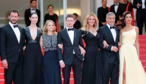 "Cannes, France - May 12, 2016: The Croissette sizzles with incredible glamour and star power as Julia Roberts, George Clooney and Jodie Foster descend on Cannes. (l to r) British actor Dominic West, Irish actress Caitriona Balfe, US director Jodie Foster, British actor Jack O'Connell, US actress Julia Roberts, US actor George Clooney and British-Lebanese lawyer Amal Clooney pose as they arrive for the screening of the film ""Money Monster"" at the 69th Cannes Film Festival.   / AFP / Valery HACHE        (Photo credit should read VALERY HACHE/AFP/Getty Images)"