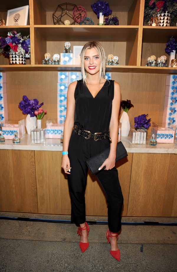 ALISSA VIOLET WEARS A VINCE CAMUTO BLACK JUMPSUIT, BELLAMY HEELS AND CARRIES AN ADDY ENVELOPE CLUTCH