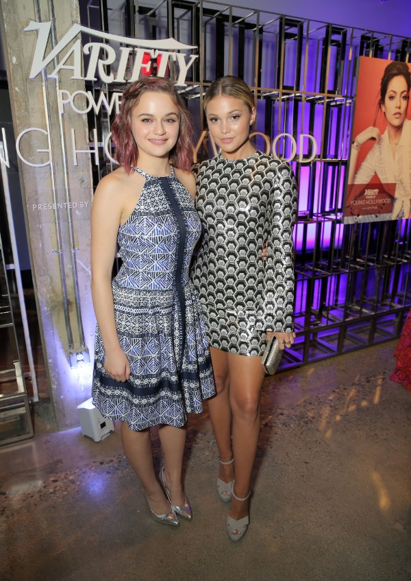 OLIVIA HOLT CARRIES A VINCE CAMUTO LUV CLUTCH & JOEY KING WEARS A VINCE CAMUTO FIT AND FLARE HALTER DRESS AND KAIN PUMPS