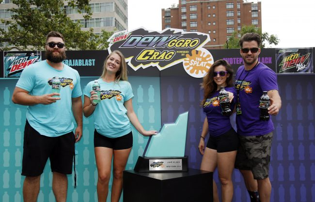 """From left, members of MTV's The Challenge Chris """"CT"""" Tamburello, Jenna Compono, Camila Nakagawa and Johnny """"Bananas"""" Devenanzio prepare to compete for the winning """"piece of the Crag"""" at the MTN DEW DEWggro Crag Powered by The Splat event, Thursday, June 16, 2016 in New York, as part of MTN DEW's DEWcision campaign. Visit DEWcision.com for more information. (Jason DeCrow/AP Images for MTN DEW)"""