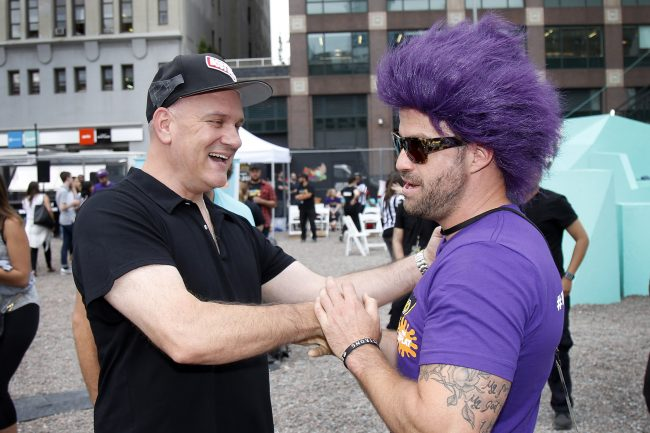 """Original GUTS host Mike O'Malley pumps up MTV's The Challenge cast member Johnny """"Bananas"""" Devenanzio before his run at the MTN DEW DEWggro Crag Powered by The Splat event, Thursday, June 16, 2016 in New York, as part of MTN DEW's DEWcision campaign. Visit DEWcision.com for more information. (Jason DeCrow/AP Images for MTN DEW)"""