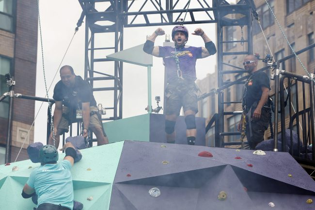 """Johnny """"Bananas"""" Devenanzio celebrates after beating fellow MTV's The Challenge cast member Chris """"CT"""" Tamburello to the top of the Crag at the MTN DEW DEWggro Crag Powered by The Splat event, Thursday, June 16, 2016 in New York, as part of MTN DEW's DEWcision campaign. Visit DEWcision.com for more information. (Jason DeCrow/AP Images for MTN DEW)"""