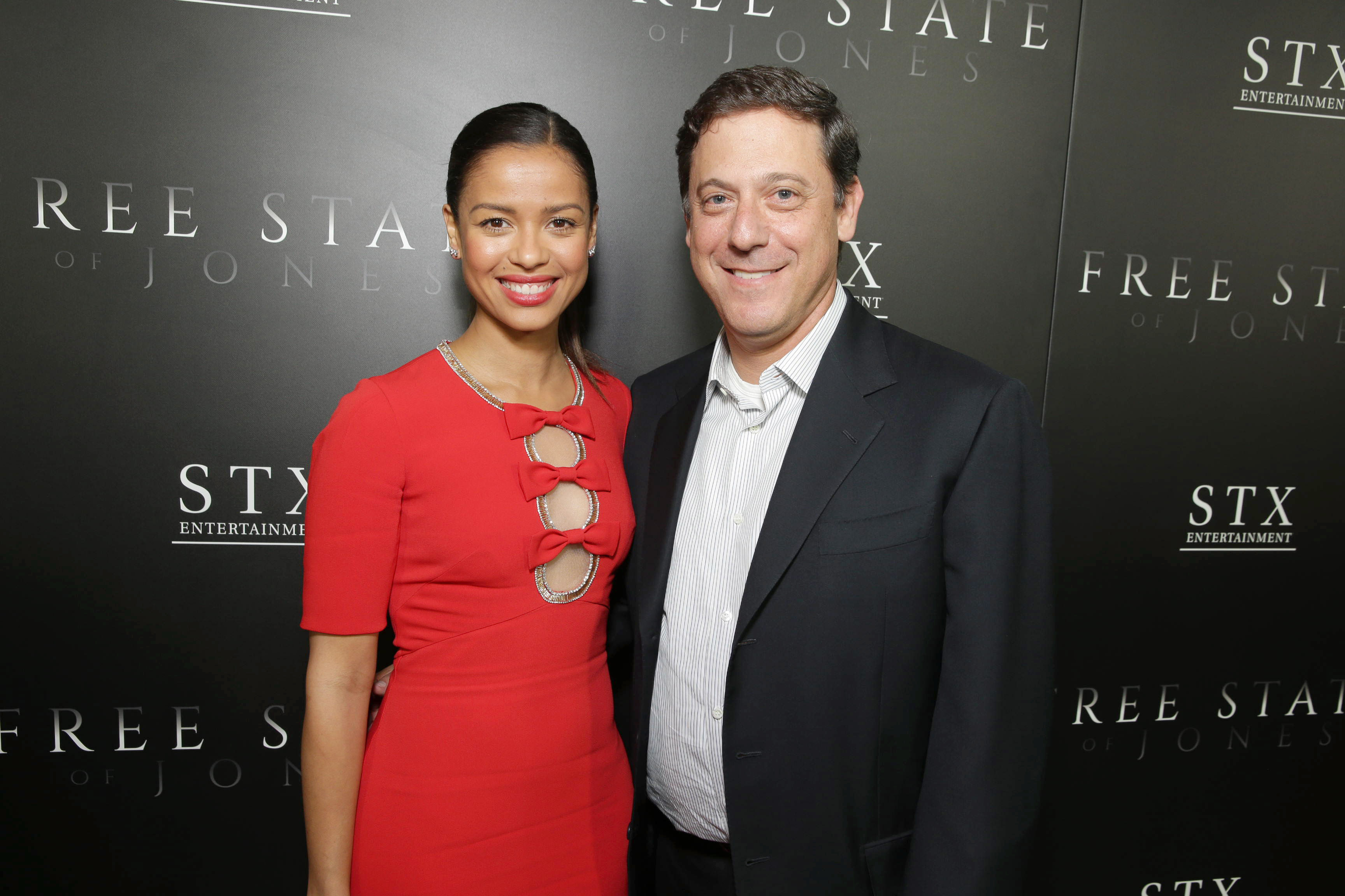 "Gugu Mbatha-Raw and Adam Fogelson, Chairman, Motion Picture Group at STX Entertainment, seen at Los Angeles Premiere of STX Entertainment ""Free State of Jones"" at DGA Theater on Tuesday, June 21, 2016, in Los Angeles. (Photo by Eric Charbonneau/Invision for STX Entertainment/AP Images)"