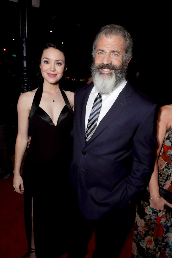"Rosalind Ross and Director Mel Gibson seen at Summit Entertainment, a Lionsgate Company, Los Angeles Special Screening of ""Hacksaw Ridge"" at The Academy's Samuel Goldwyn Theater on Monday, Oct. 24, 2016, in Beverly Hills, Calif. (Photo by Eric Charbonneau/Invision for Lionsgate/AP Images)"