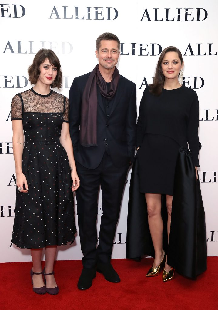 "LONDON, ENGLAND - NOVEMBER 21:  (L-R) Lizzy Caplan, Brad Pitt and Marion Cotillard attend the UK Premiere of the Paramount Pictures Film ""Allied"" Odeon Leicester Square on November 21, 2016 in London, England.  (Photo by Mike Marsland/Mike Marsland/Getty Images for Paramount Pictures) *** Local Caption *** Lizzy Caplan; Brad Pitt; Marion Cotillard"