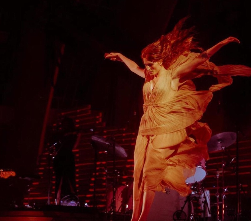 Florence Welch performing at the Hollywood Bowl with Florence + The Machine